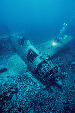 Diver Meredith Eder exploring wreck of a WWII Corsair aircraft, Solomon Islands  -  Norbert Wu