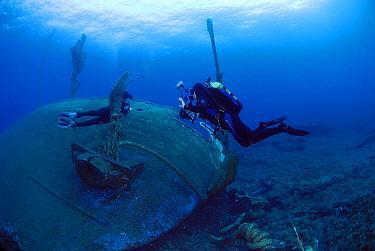 Underwater photographer taking photos of model and shipwreck, Mediterranean Sea  -  Hans Leijnse/ NiS