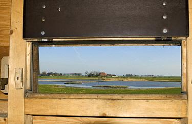 Landscape seen from inside birdwatching hut, Friesland, Netherlands  -  Philip Friskorn/ NiS