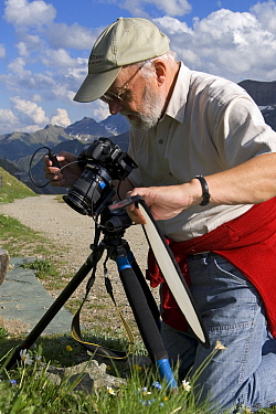 Photographer Fritz Polking at work, Heiligenblut, Hohe Tauern National Park, Austria  -  Willi Rolfes/ NIS