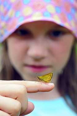A young girl with a butterfly on her finger, Valgamaa, Estonia  -  Sven Zacek/ NiS