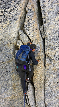 Mountaineer climbing rock face  -  Jasper Doest