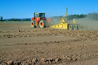 Grading land before rice growing, automatic control of grader height by laser beam, Murrumbidgee River area, N.S.W., Australia  -  Peter E. Smith/ FLPA