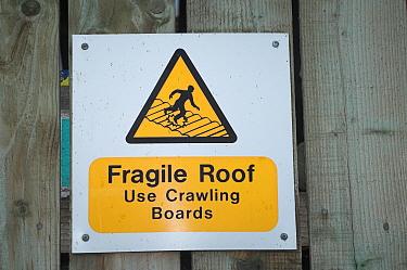 Fragile Roof Use Crawling Boards', warning sign on side of farm building, England  -  Wayne Hutchinson/ FLPA