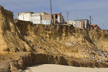 Coastal erosion, cliffs eroded by sea, damaged buildings on clifftop, Happisburgh, North Norfolk, England  -  David Burton/ FLPA
