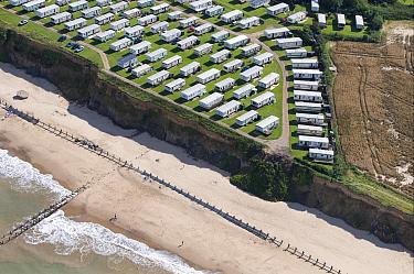 Aerial view of clifftop caravan park, sea defences and cliff erosion, Happisburgh, Norfolk, England  -  David Burton/ FLPA