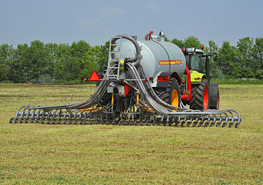 Slurry tanker with injector, injecting slurry into grassland, England  -  John Eveson/ FLPA