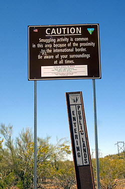 Caution, smuggling activity' and 'Entering Public Lands' signs in desert, Ironwood Forest National Monument, Arizona  -  Mark Newman/ FLPA