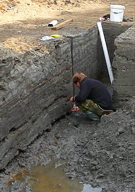 Happisburgh archaeological dig, person digging in trench on beach, at oldest human site north of Alps, Happisburgh, Norfolk, England, june  -  Neil Bowman/ FLPA