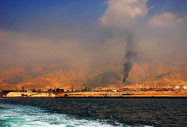 View of port and oil refineries, Zagros Mountains in distance, Assalouyeh, Pars Special Energy Economic Zone, Persian Gulf, Southern Iran  -  Colin Munro/ FLPA