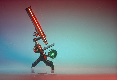Old brass microscope with starburst and coloured background  -  Nigel Cattlin/ FLPA
