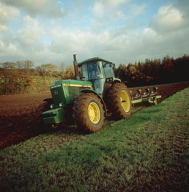 John Deere tractor and coulter plough ploughing grassland to replant in autumn  -  Nigel Cattlin/ FLPA