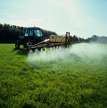 Old Ford tractor and boom sprayer spraying grass ley for renovation  -  Nigel Cattlin/ FLPA