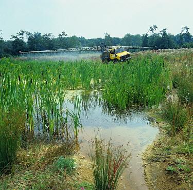 Unimog mounted sprayer spraying off vegetation around pond edge with glyphosate  -  Nigel Cattlin/ FLPA