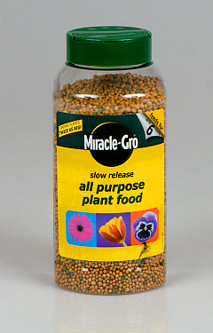 Plastic container of Miracle-Grow, slow release all-purpose plant food granules  -  Nigel Cattlin/ FLPA