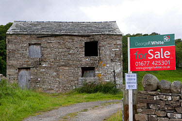 Rural farm barn with planning permission, with 'For Sale' sign outside, North Yorkshire, England, august  -  Wayne Hutchinson/ FLPA