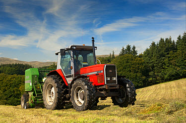 Massey Ferguson tractor with McHale baler, round baling silage in meadow, Yorkshire Dales, Yorkshire, England, september  -  Wayne Hutchinson/ FLPA
