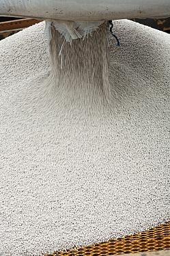 Emptying bag of nitrogen granular fertilizer granules into fertilizer spreader, Sweden, may  -  Bjorn Ullhagen/ FLPA