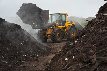 Volvo loader turning green compost waste for aeration at municipal waste site, near Chester, Cheshire, England, march  -  John Eveson/ FLPA