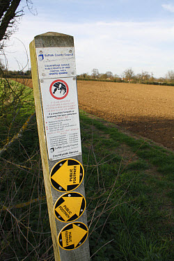 Public footpath sign with regulations for restoring disturbed crossfield footpaths, at edge of field in arable farmland, Bacton, Suffolk, England, april  -  Marcus Webb/ FLPA