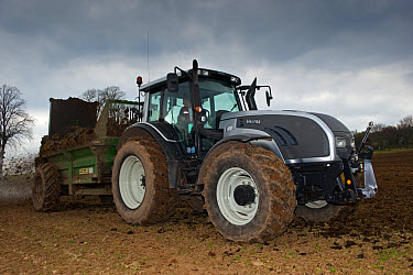 Valtra T tractor with muck spreader, spreading muck on arable field, England, march  -  Wayne Hutchinson/ FLPA