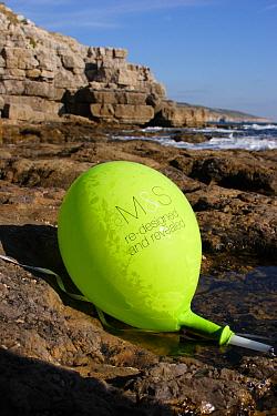 Balloon washed up on rocky shore, Dancing Ledge, Dorset, England, october  -  Steve Trewhella/ FLPA