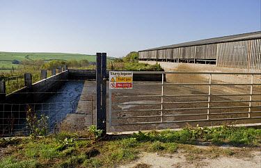 Slurry Lagoon, Toxic Gas, No Entry' sign on gate at open slurry store for dairy cattle, Dorset, England, october  -  Chris Brignell/ FLPA