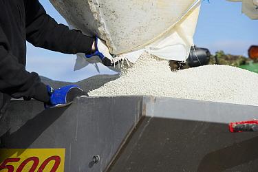 Filling Bredal TX spreader with granular fertilizer, Tierp, Uppsala County, Uppland, Sweden, april  -  Bjorn Ullhagen/ FLPA
