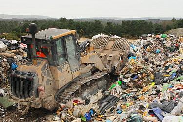 Bulldozer moving rubbish on landfill tip, Dorset, England, February  -  Steve Trewhella/ FLPA