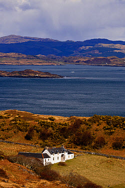 View of coastline and remote farmhouse, former home of George Orwell where he wrote 'Nineteen Eighty-Four' novel, view across Sound of Jura to mainland, Barnhill, Isle of Jura, Inner Hebrides, Scotlan...  -  Konrad Borkowski/ FLPA