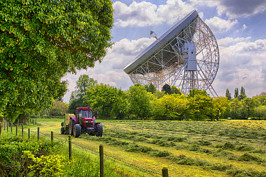 Radio telescope with tractor and baler baling silage in foreground, Lovell Telescope, Jodrell Bank Observatory, Cheshire, England, June  -  John Eveson/ FLPA