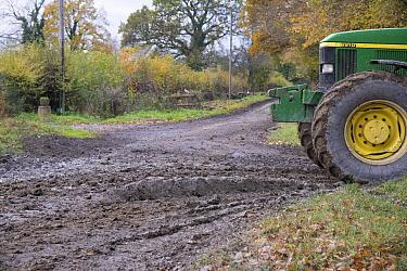 John Deere tractor beside muddy country road, Welshpool, Powys, Wales, November  -  John Eveson/ FLPA