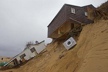 Eroded sea cliffs and damaged chalets after December tidal surge, Hemsby, Norfolk, England, January  -  Roger Tidman/ FLPA