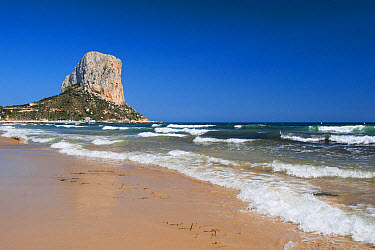 View of sandy beach and massive limestone outcrop, Penyal d'Ifac, Calpe, Marina Alta, Costa Blanca, Alicante Province, Valencia, Spain, May  -  Wayne Hutchinson/ FLPA