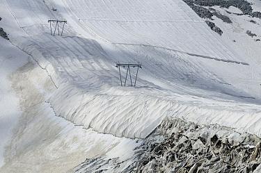 Protective textile covering to delay snow melting on skiing slope with ski lift, Presena Glacier, Italian Alps, Italy, July  -  Fabio Pupin/ FLPA