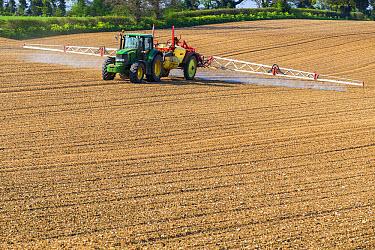 John Deere tractor with sprayer, weed pre-emergence spraying on sugarbeet field, Norfolk, England, April  -  Gary K Smith/ FLPA