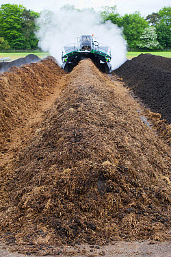 Komptech self-propelled compost turner, turning over rotting bedding manure, England, June  -  Wayne Hutchinson/ FLPA