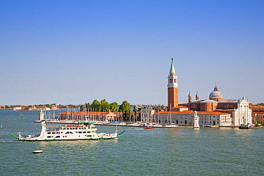 View across waterway towards tourist boat and th century Benedictine church, Church of San Giorgio Maggiore, San Giorgio Maggiore, San Marco district, Venice, Veneto, Italy, May  -  Dickie Duckett/ FLPA