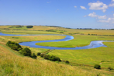 View of meandering river in coastal floodplain, River Cuckmere, Seven Sisters Country Park, Cuckmere Haven, East Sussex, England, June  -  John Watkins/ FLPA