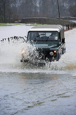 Land Rover driving through flooded road, Cumbria, England, December  -  Wayne Hutchinson/ FLPA