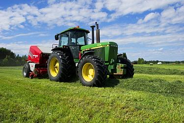 John Deere tractor and Welger baler, baling silage crop, Sweden, June  -  Bjorn Ullhagen/ FLPA