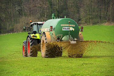 Claas tractor with slurry tanker, spreading slurry on grassland, near Longridge, Lancashire, England, April  -  John Eveson/ FLPA