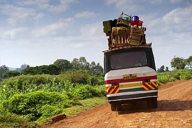 Overloaded van on rural road, Kenya, June