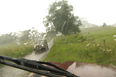 View through car windscreen during downpour, country lane, Yorkshire, England  -  Rob Cousins/ npl