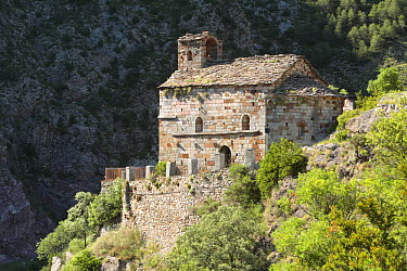 Romanic hermitage clinging to the hillsides of Arbol? in the Pyrenees mountains Catalonia, Lerida, Spain  -  Juan Manuel Borrero/ npl