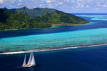 Aerial view of SY Adele, 180 foot Hoek Design, underway close to the reef off Huahine Island, French Polynesia  -  Rick Tomlinson/ npl