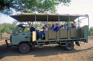 Tourists in Safari truck to see animal in Simunye Zulu Lodge Game Reserve, South Africa  -  Dan Burton/ npl