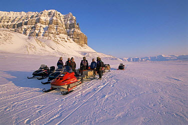 BBC NHU film crew travelling by snow mobile in search of Polar bears, on location for 'Blue planet', Svalbard, Norway, April 1996  -  Mats Forsberg/ npl