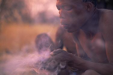 Jo, Hoan bushman making fire by traditional method, Bushmanland, Namibia 1996  -  Owen Newman/ npl