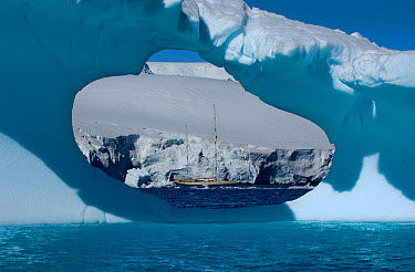 SY Adele, 180 foot Hoek Design, seen in the distance through an ice window motoring in the Lemair Channel, Antarctica, January 2007  -  Rick Tomlinson/ npl